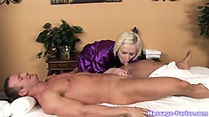 Blonde masseuse gives him a massage and massages his cock with her mouth