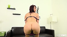 Nikki starts undressing and showing off her bald pussy lips and ass