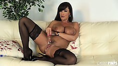 Gorgeous Lisa Ann fucks herself wearing black nylon stockings