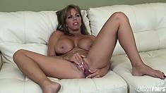 Passionate vixen Amber Lynn Bach masturbates tenderly on a big bed