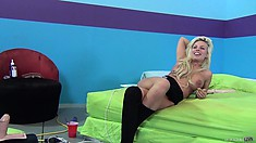 Chubby blonde with big tits rides on a sybian till she climaxes