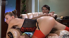 Sexy lesbian couple Lily M and Aubrey work each other's pussies with a strap-on