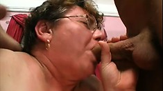Chubby mature slut Cathy gets spit roasted in a hot threesome