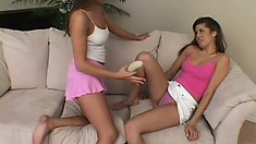 Lesbian sweeties get their toy out and go to work fucking with a strapon