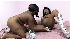 Tifffany Stacks makes sure Marshae's pussy is wet enough for the dildo