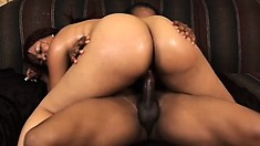 Big booty black bitch knows how to shake that ass on his cock after blowing him