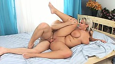 Curvy blonde MILF with great knockers gets banged balls deep
