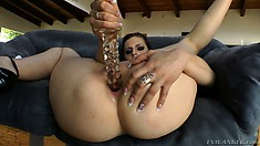 Voluptuous brunette uses a few sex toys to properly stretch her holes