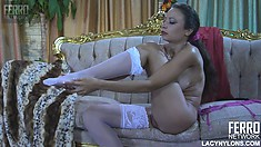 Amateur Annie demonstrates her legs in white stockings and other private parts of her body