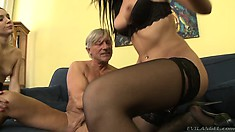 Two perverse babes in black lingerie pleasure their sugar daddy