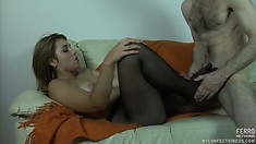 Horny broad in stockings teases her lover's cock with a footjob
