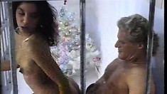 Sexy brunette blows a big cock and enjoys a deep fucking behind bars