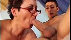 Chubby granny entertains her two young neighbors with a threesome