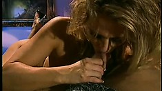 Marilyn gets his rod nice and hard sucking on it so he can drill her twat