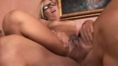 Tattooed blonde in glasses eats his meat and gets her twat reamed