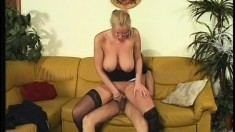 Blonde cougar with big hooters loves to get fucked hard by a young guy