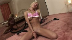 Delightful blonde lies on the floor and makes herself cum with a dildo
