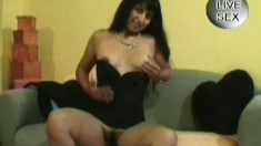 Long haired brunette strips off her clothes and makes herself cum hard