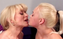 Nina Hartley gets a young blonde to take her big red strap-on deep
